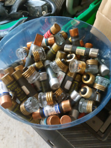 Assortment of used but working electrical fuses