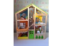 Hape furnished wooden dolls house with extras