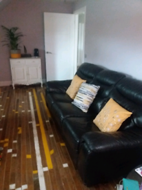 Black Leather 3 seater sofa/couch/settee turns into sofa bed