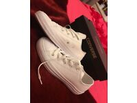 Brand new all star leather converse size 4