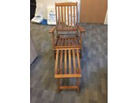 Two wooden lounger chairs