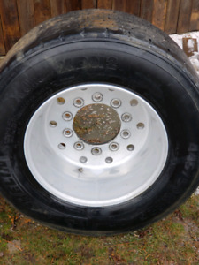 Supper single wheels.  With michelin tires 445 50 22.5 good cond