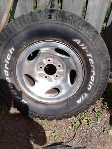 265-75-16 ford f-150 nitogren filled chrome rim with bf goodrich