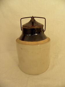 antique earthen ware jug with lid