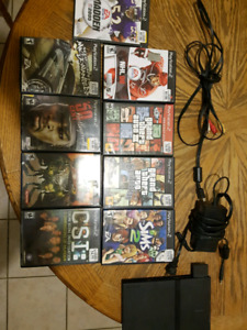 Ps2  with all cords, 2 controllers, 9 games