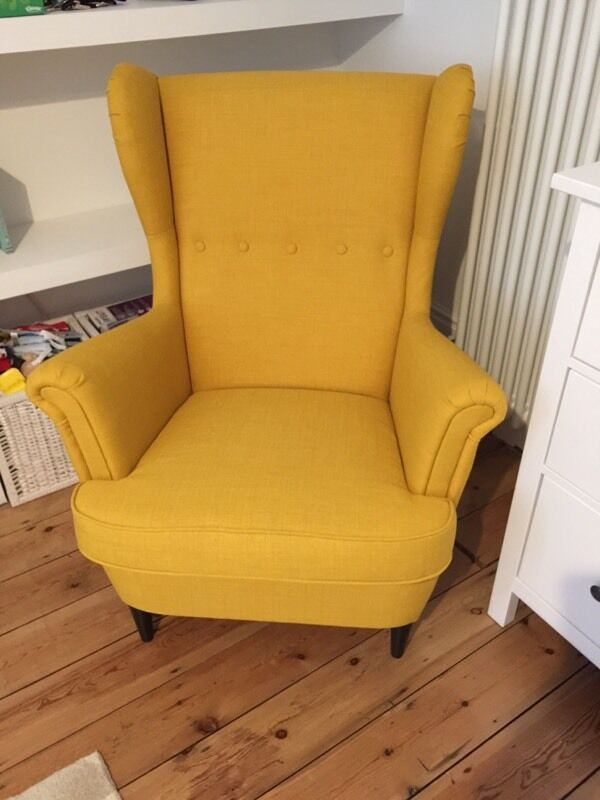 ikea strandmon yellow chair in wood green london