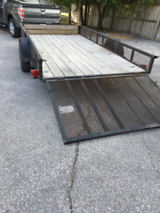 2012 Black Utility Trailer With Side Ramps.
