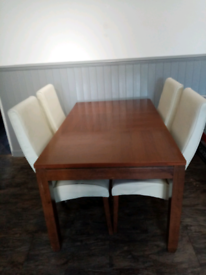 Solid dinning room table and 4 chairs