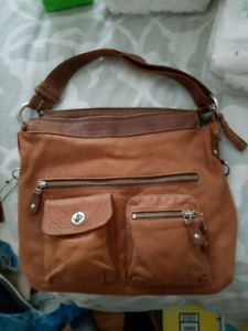 $120 roots natural leather bag