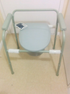 Commode for sale, never used, with pot, lid and cover