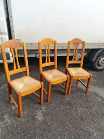 3 pinewood dining room chairs with wicker seats £30 the set