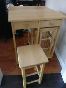 Folding table with wheels. and two chairs $25
