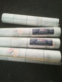 Wallpaper vinyl wall covering. Light blue. £3 each