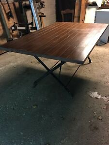 Solid wood and wrought iron folding dining table