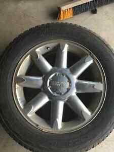 "Set of four 20"" stock tires and rims for GMC."