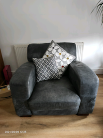 Comfortable armchair and matching footstool with storage