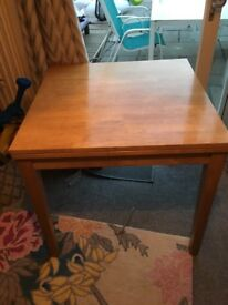 Solid wooden fold over extending table