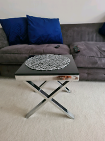 Beautiful side table...chrome legs and top glass...delivery