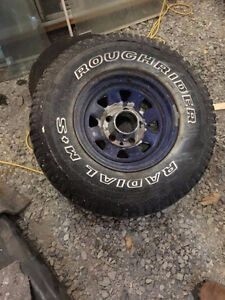 4 Roughrider tires EUC on ford rims