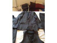Slim fit charcoal grey 3 piece suit