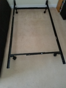 BRAND NEW ADJUSTABLE METAL BED FRAME-adjusts from Twin to Queen