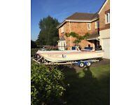 17 feet open dory 115hp Suzuki fourstroke twin axle roller trailer