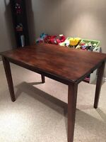 Bar height dining table.