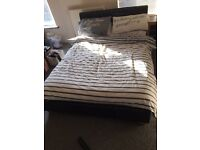 Leather look double bed with mattress