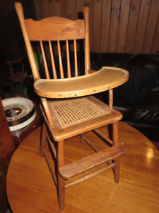 a VINTAGE WOODEN HIGH CHAIR NOT FOR USE WITH CHILDERN