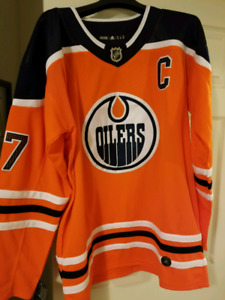 Connor Mcdavid Oilers home jersey.