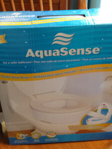 Brand new, never opened raised toilet seat
