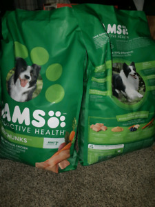 Two brand new unopened bags of dog food