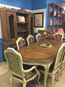 Table, 8 chairs with 3 leaves and china cabinet