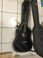 Acoustic guitar and hard case