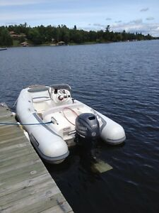 $23.000 + TO REPLACE THIS LITTLE USED WALKER BAY 360 BOAT