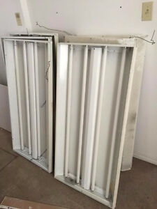 Eight 2x4 4 light T8 light fixtures - all in working condition