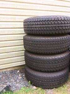Truck tires on rims in mint condition!