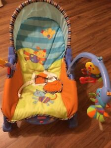 Fish and price rock chair, musical mobile