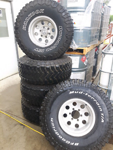 Five 35x12.5x15 tires and 6 bolt wheels