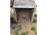 Log wood storage shed