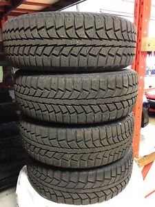 195 65 15 Nissan Sentra winter tires on steel rims