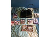 PlayStation 3 40gb 2 controllers and 8 games