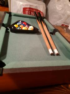 Mini billiard table.