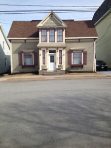 Very charming Victorian home West!! In law suite potential!!