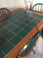 PRICE DROP-- ceramic kitchen table with 4 sturdy chairs!!!!!