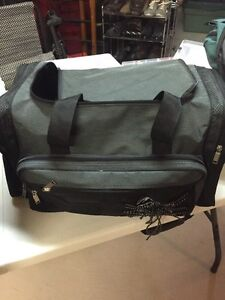 Tackle bag loaded with fishing lures