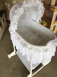 White bassinet with light and music option