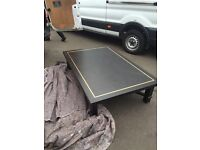 Black and gold large wooden table