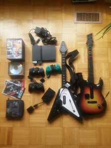 PlayStation 2 + 3 Controllers + 2 Guitar Controllers + Games