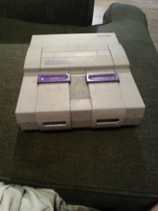 Super Nintendo with broke eject button + game manuals
